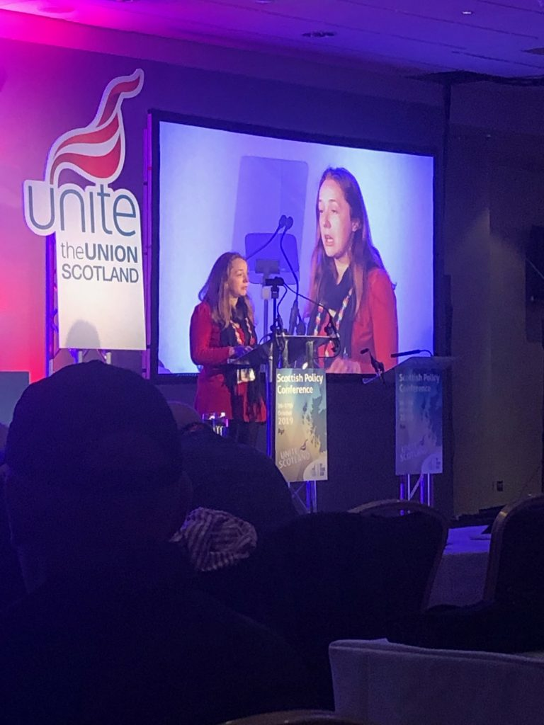 Unite CEC rep Amanda Cunningham address the conference from the podium